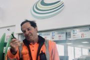 Man in orange hi viz at Channel Ports with two way radio