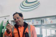 Man in orange hi viz at Channel Ports with two way radio