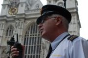 Security guard in front of cathedral with two way radio