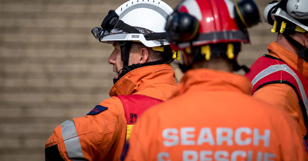 search and rescue men preparing for a genuine emergency