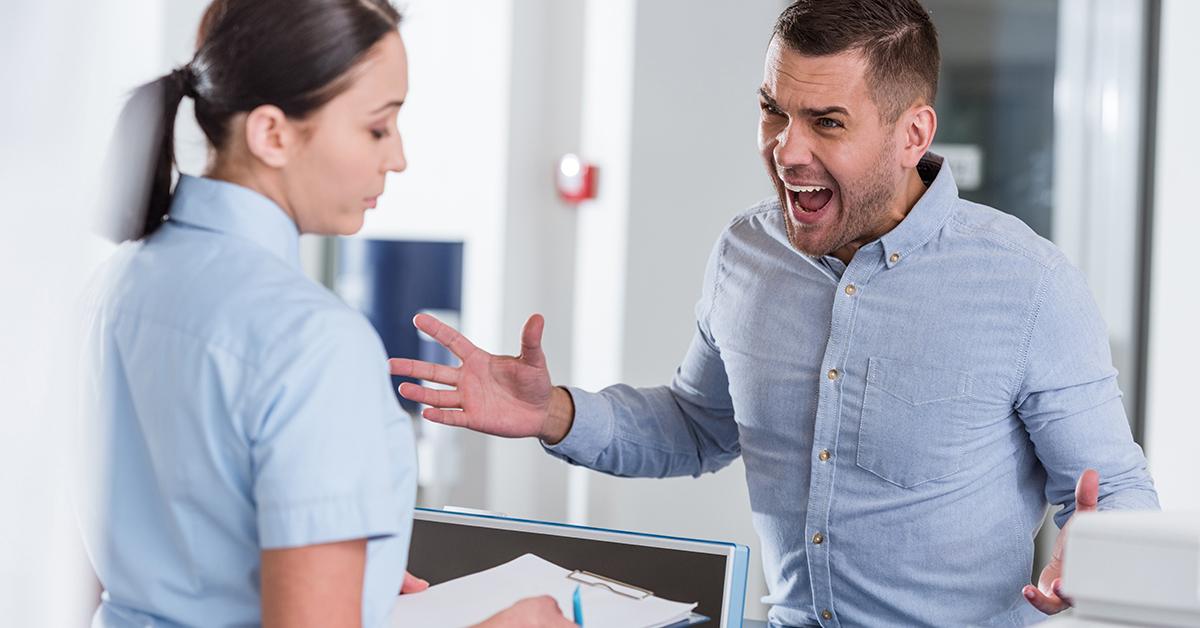 Aggressive man shouting at woman